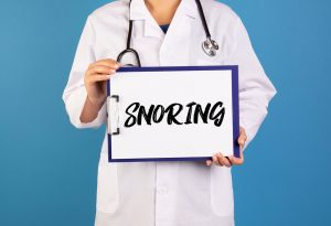 Doctor holding snoring board