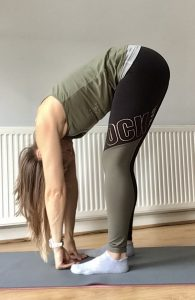 Standing forward fold pose yoga